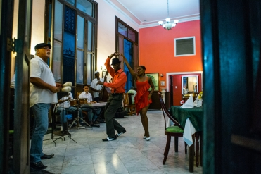 March 5-12, 2017 - Boston, MA. Live Cuban music and dance fill a restaurant on Calle Obispo in Old Havana. 2017 Alternative Spring Break in Havana, Cuba. Photographed by Janice Checchio for Boston University.